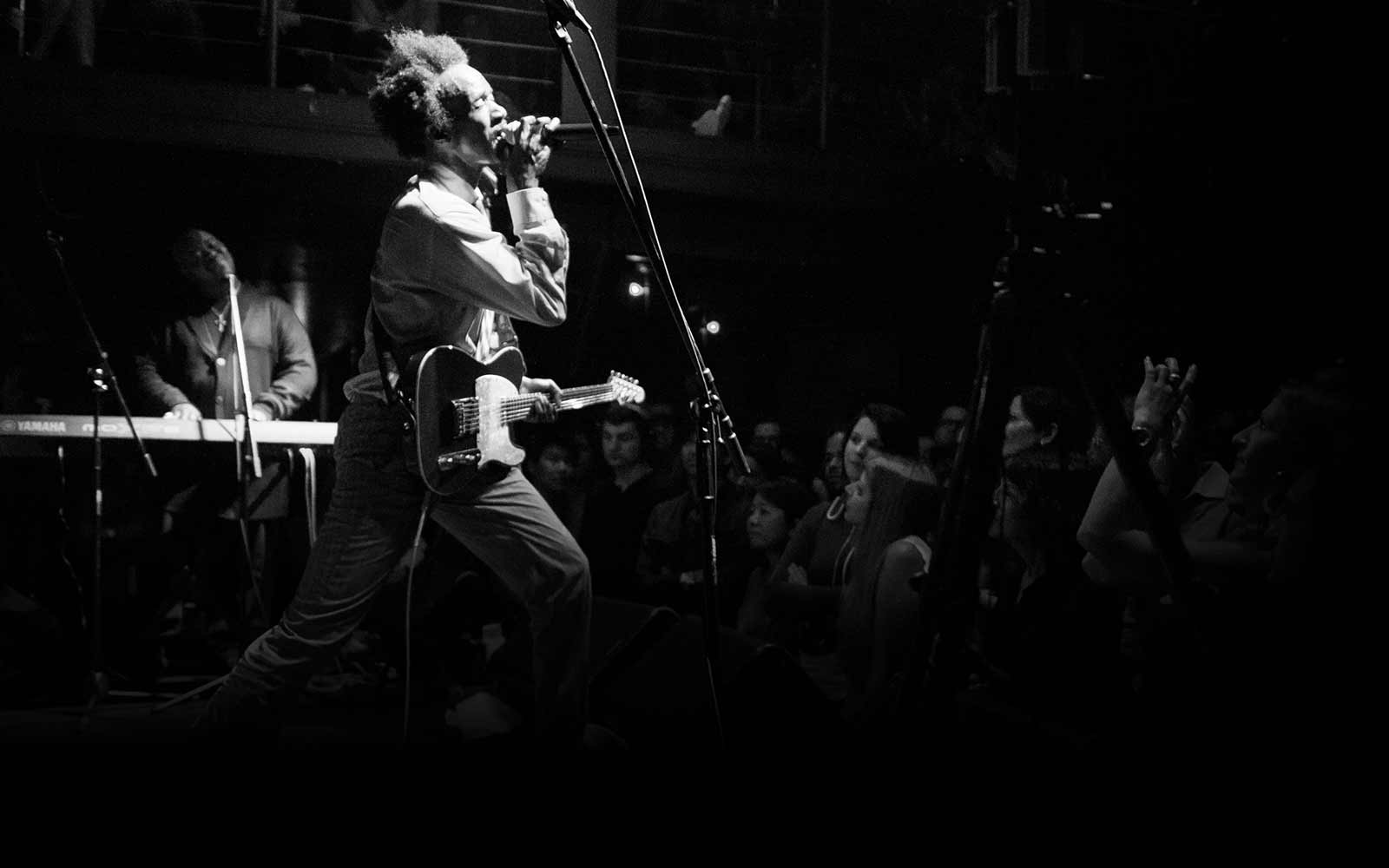 An image of Fantastic Negrito performing